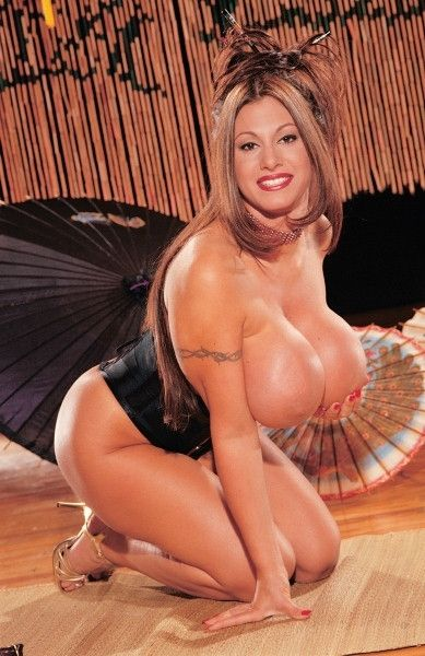 Crystal Gunns in corset and heels shows off her monster melons and fingers her hole