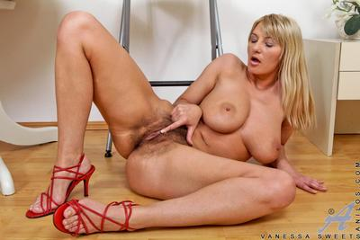 Lusty big titted blonde Lovely Vanessa losing off lingerie and playing with hairy nub