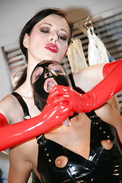 Kinky BDSM lezdom sex with busty latex attired lesbians in boots and mask