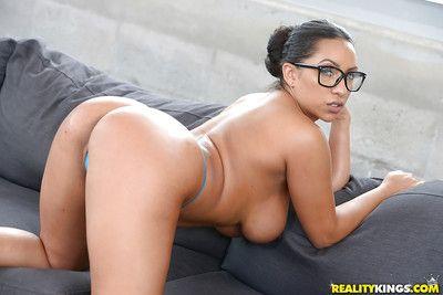 Glasses adorned Latina babe Priya Price flashing large all natural tits