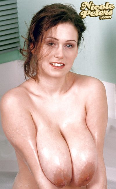 Amateur solo model Nicole Peters wetting monster boobs in bathtub