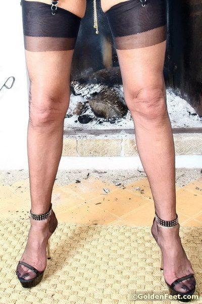 Aged British dame Lady Sarah modeling nylons while revealing pierced twat