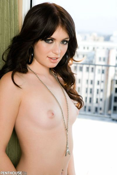 Brunette Ashlyn Rae with small tits and shaved mouth gets nude after posing on balcony