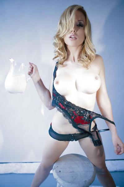 Covering her body with milk is what blonde big tit babe Kayden Kross does best.