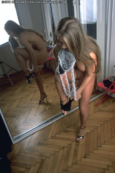 Big breasted Rita Faltoyano demonstrates her naughty parts by the mirror