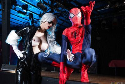 Blonde latex attired cosplay enthusiast with big tits giving big cock a bj