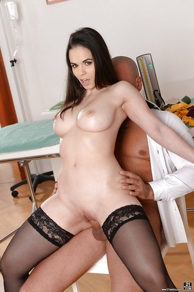 Busty chick Nekane having sex with her doctor in black stockings
