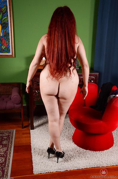 Mature redhead Laila unveiling large boobs while flaunting fat belly