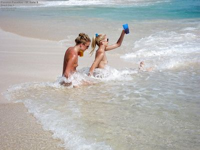 Naked amateur teenage babes in sunglasses having some fun on the beach