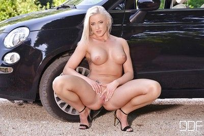 Clothed blonde Vicktoria Redd stripping of short skirt and lingerie by car