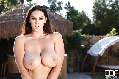 Brunette solo model Alyson Tyler letting huge knockers loose from bikini
