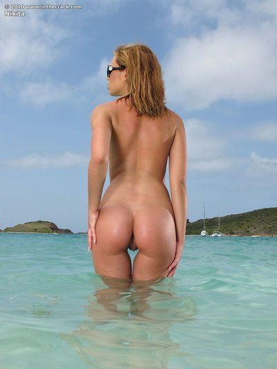 Nikita loses her bikini and shows off every inch of her adorable tight body on a tropical beach