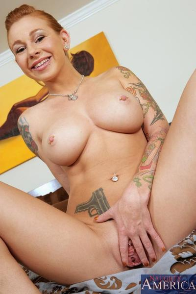 Shaved tattooed babe Scarlett Pain shows her nice boobs and ass before she gets nailed