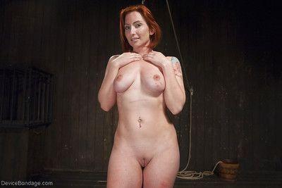 Redhead girl Sophia Locke taking electroshock and nipple torture in bondage