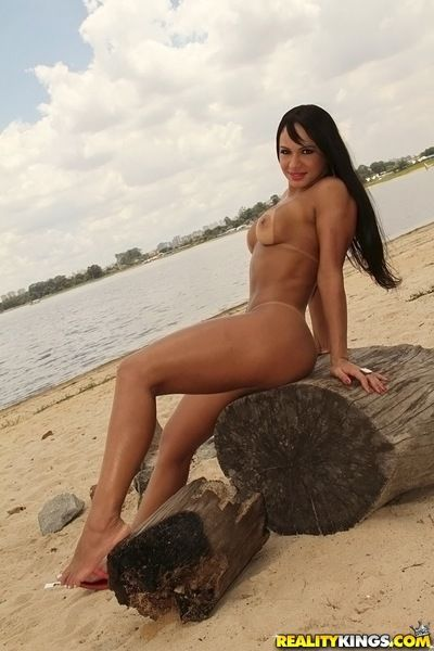 Voluptuous latina babe with tanned skin gets rid of her bikini outdoor