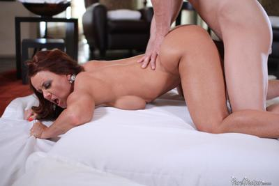 Busty milf Janet Mason moistens dick with mouth and then easily gets it in nub