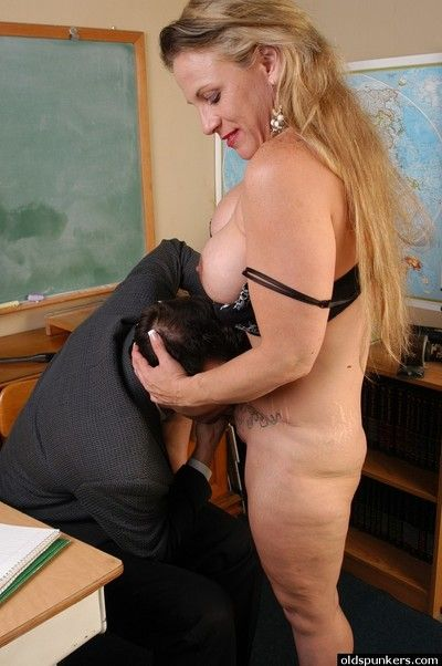 Older blond teacher Summer licking ball sac and eating cumshot in classroom