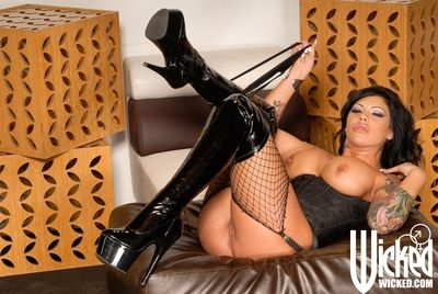 Tattooed busty brunette Mason Moore in fishnet stockings and high latex boots shows her snatch