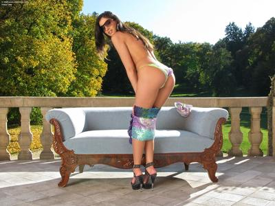 Tiny titted Czech babe Lucy Lee in sunglasses poses outdoors with speculum inside her pussy