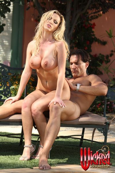 The busty bimbo Nikki Benz is naked outdoor riding and sucking the stiff dick
