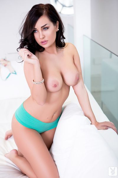 Impressive brunette stimulates her soft tits and shaved pussy in alluring solo