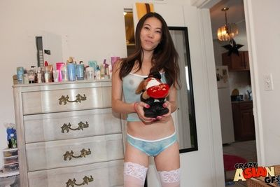 Naughty Asian amateur Lily showing off her smooth Oriental pussy