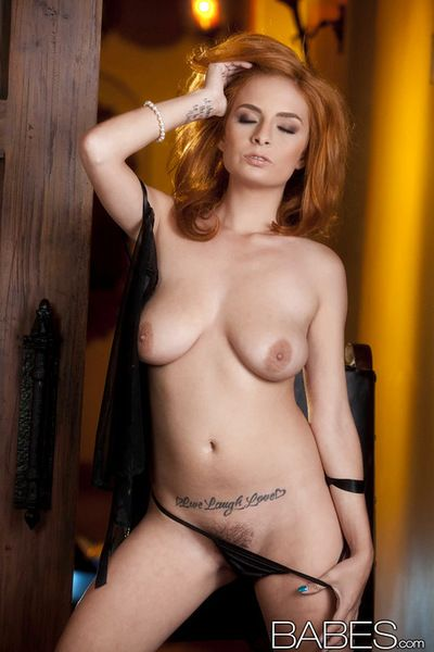 Insolent redhead removes her nighty to pose sexy and play with her shaved cunt