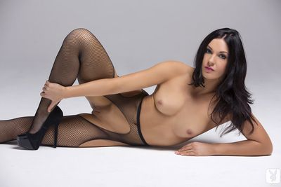 Sexy brunette Alessandra removes her fishnet stockings during hot solo action