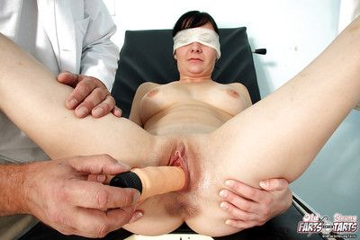 Young brunette girl being examined by kinky doctor that blindfolds her