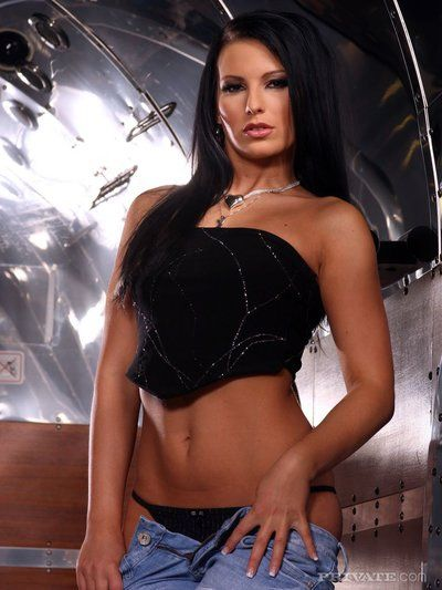 Naughty european brunette Mili Jay removes her blue jeans and black panties