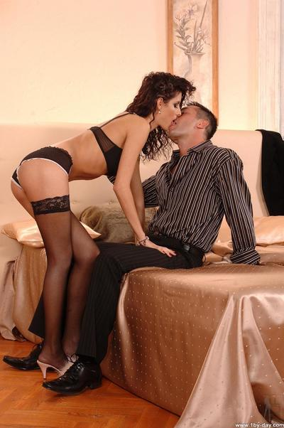 Seducing Leana Sweet in black stockings hold by guy on his erected cock and fucking.