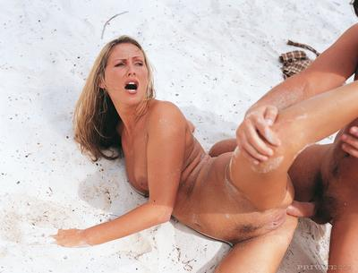 Huge nude blonde Mandy Bright enjoys anal sex in sand on the wild beach