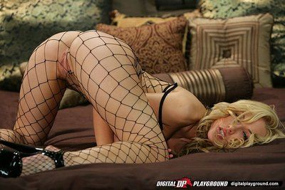 Filthy big titted doll in fishnets Kayden Kross is swinging on sticking piston