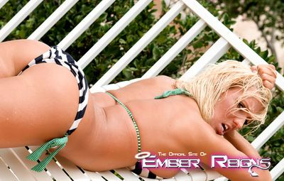 Ember Reigns likes to pose her big tits and that amazing ass while at the pool