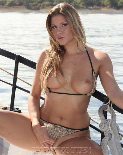 European bikini babe Monica Sweetheart shows her tits and flashes her bush outdoors
