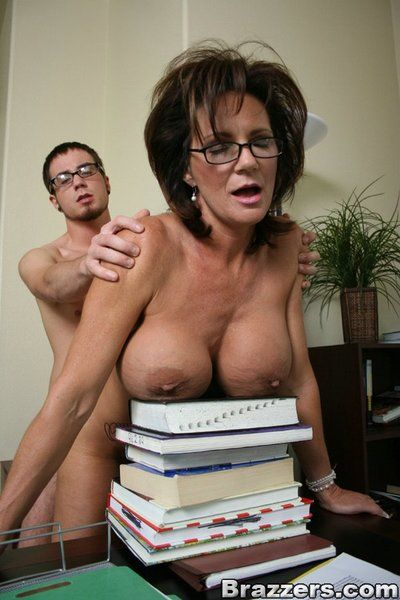 Huge titted sexpot Deauxma in glasses rides cock like crazy in the office.