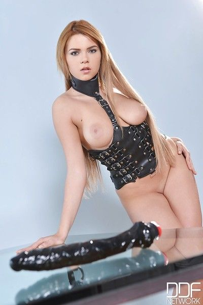 Busty babe Marina Visconti plays with handcuffs and black dildo
