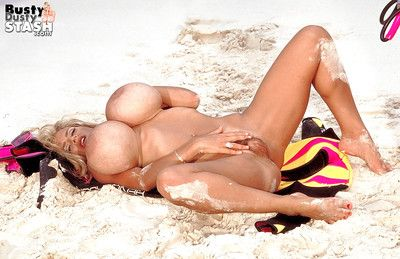 Mature beach babe Busty Dusty loosing monster boobs from bikini outdoors