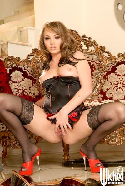 Gorgeous babe with round ass Charlie Laine poses in black corset and stockings