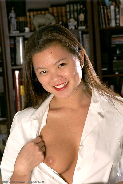 Asian first timer Tina revealing firm tits and hairy cunt while undressing