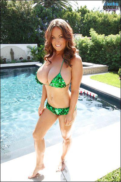 Sexy big tit pornstar Sarah Nicola swimming in the pool