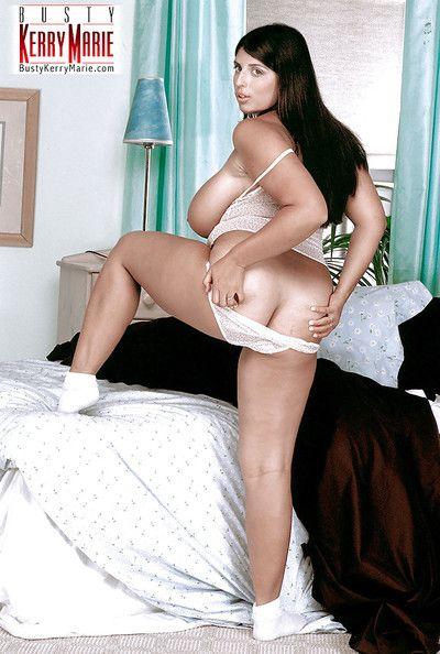 European solo girl Kerry Marie unleashing huge pornstar tits in white socks