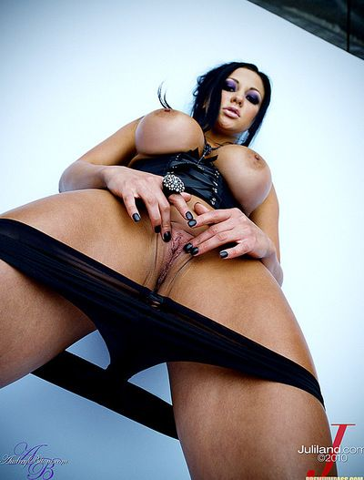 Shameless and vulgar brunette Audrey Bitoni with big tits is fingering her hungry slit