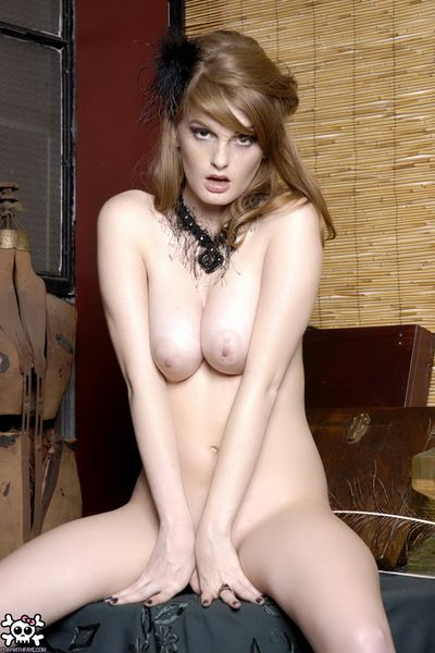 Cute babe Faye Valentine in boots takes off her dress and lingerie then fingers her neat pussy.