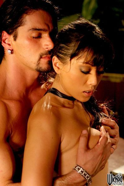 Salacious Asian babe in a tie Avena Lee beads her pussy on the cock and has a ride on it