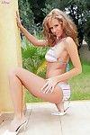 Spicy curly haired babe Zuzana Drabinova strips her bikini and shows her full tits outdoors