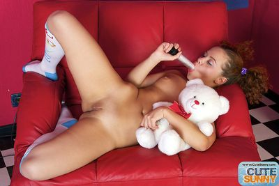 Curly teen feels like deep masturbating her pussy with a big toy