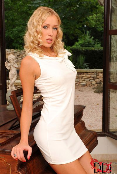 Alluring and charming blonde in white suit is here to enter her orange sextoy in her pussy