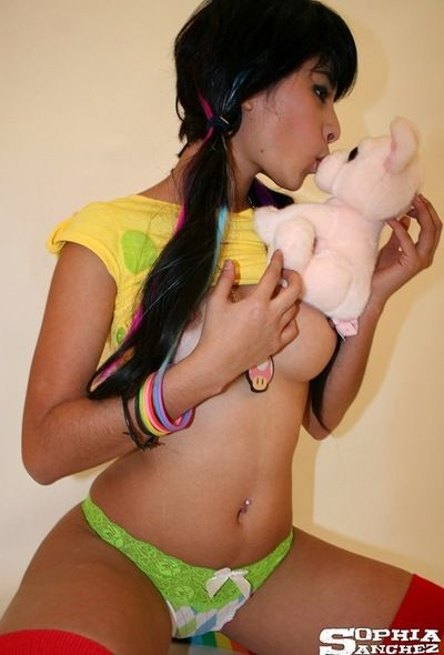 Colorful outfit on hot youthful model Sophia Sanchez hanging out in socks and panties