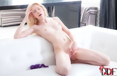 Small chicito enjoys undulating her body while fingering her twat and hard tit pointers